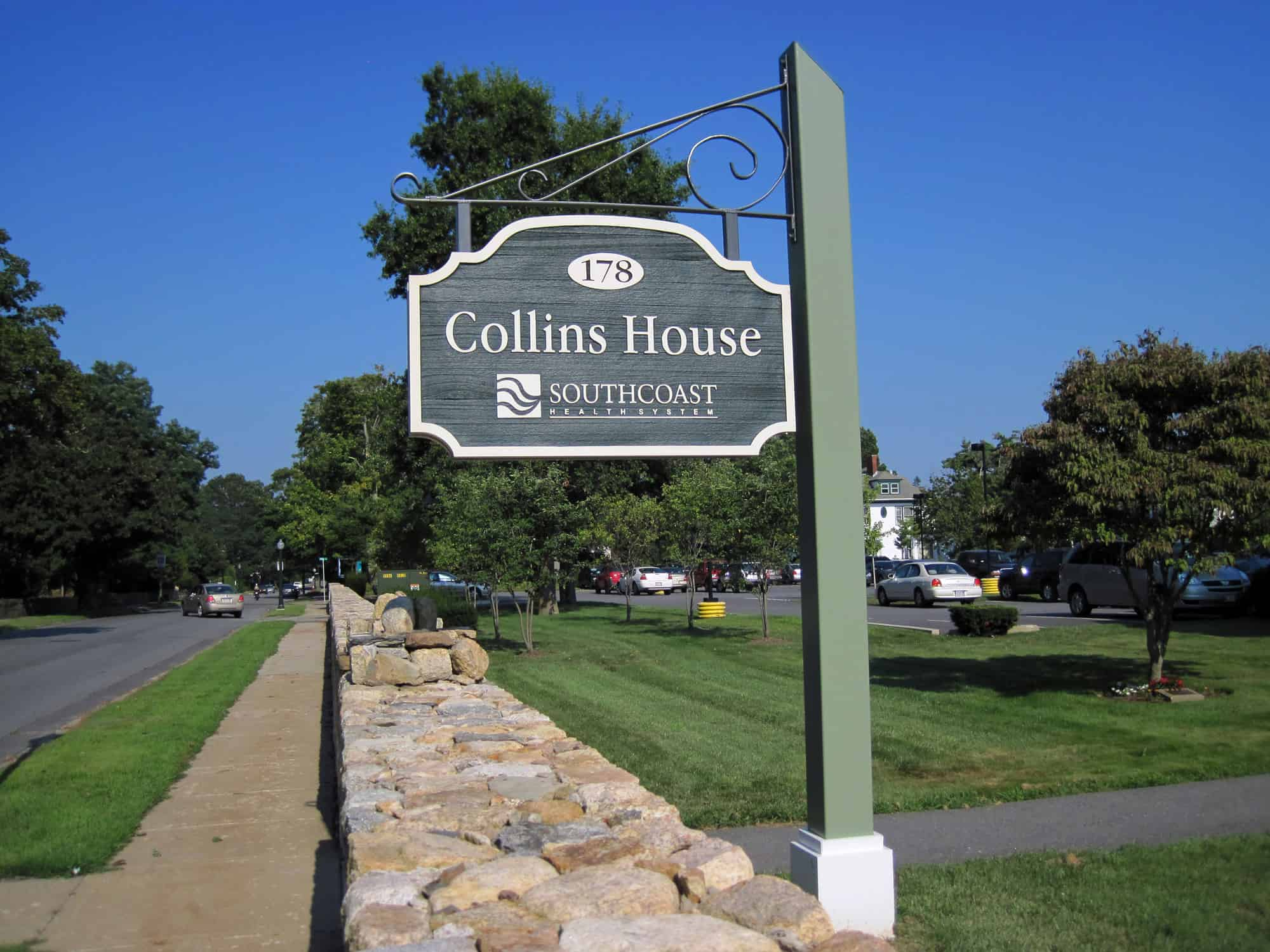 Post sign for Collins House