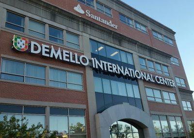 Demello Building Sign