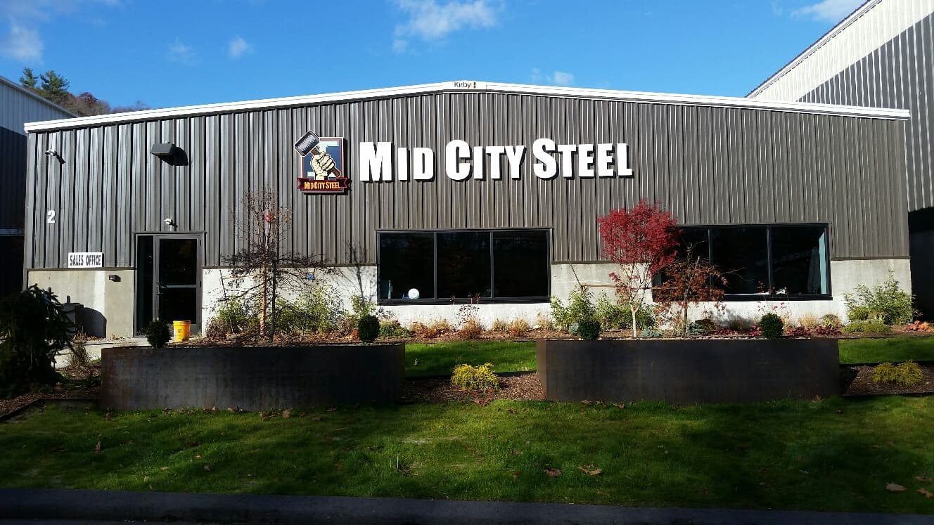 Mid City Steel Building Sign