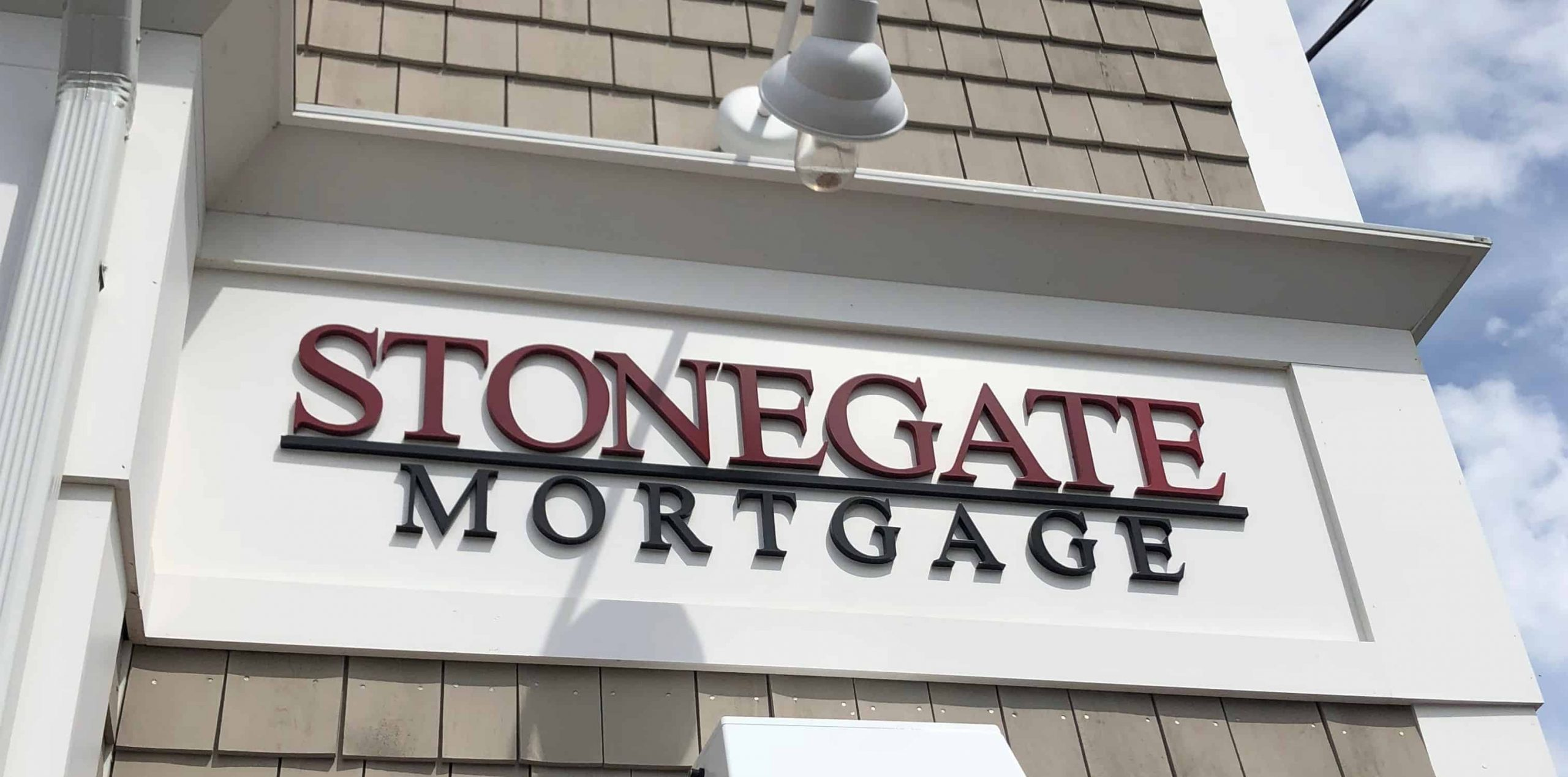"Dimensional letter sign showing ""Stonegate Mortgage"""