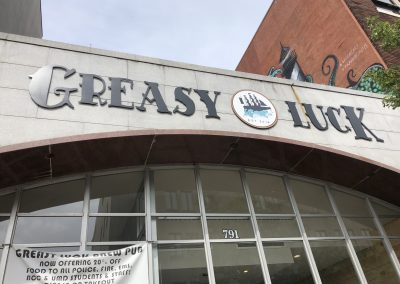 Greasy Luck Building Sign